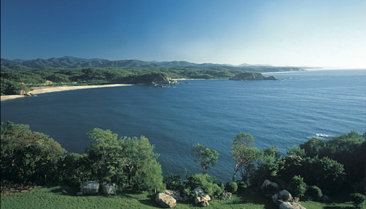 Huatulco real estate ownership property overlooking bay, oceans, mountains and greenery.