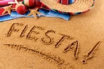 The word Fiesta! written in to the sand on Huatulco beach during celebration.