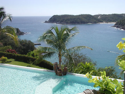 Looking over infinity pool to Huatulco bay from the 2nd story terrace of the Sueno Real real estate development.